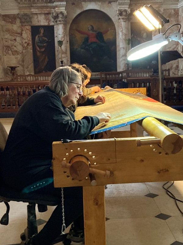 Tapestry repairs being carried out in the Chapel